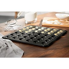 Baking tray for crescent-shaped cookies